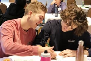 Two boys discuss project at Youth Climate Leaders Academy retreat, Dec 2017.